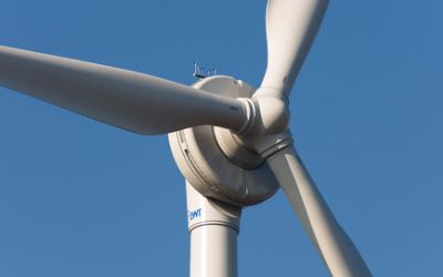 A wind turbine on a clear and bright day